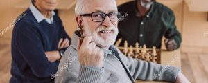 depositphotos_172877148-stock-photo-senior-friends-playing-chess